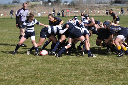 BLAINE, MN - APRIL 30: A scrum in a women?s collegiate rugby match between Navy and the Brigham Young University (BYU) Cougars in the NCAA Division I College Championship quarterfinals on April 30, 2011 in Blaine, MN