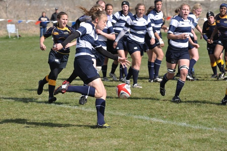 collegiate: BLAINE, MN - APRIL 30: Unidentified BYU player about to kick the ball in a womens collegiate rugby match between Navy and the Brigham Young University (BYU) Cougars in the NCAA Division I College Championship quarterfinals on April 30, 2011 in Blaine, MN Editorial