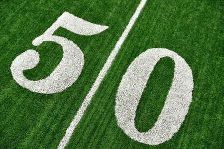 yardline: View From Above of 50 Yard Line on American Football Field With Artificial Turf