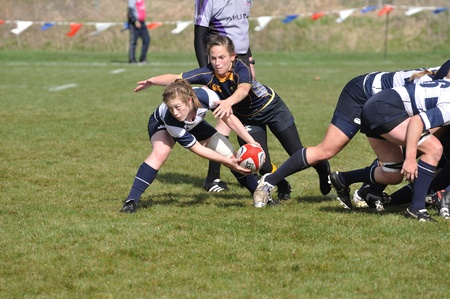BLAINE, MN - APRIL 30: Unidentified BYU player about to pass the ball After a scrum in a womens collegiate rugby match between Navy and the Brigham Young University (BYU) Cougars in the NCAA Division I College Championship quarterfinals on April 30, 2011