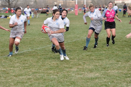 BLAINE, MN - APRIL 30: Unidentified North Carolina player running with ball in womens collegiate rugby match between  Army and the North Carolina Tar Heels in the NCAA Division I College Championship quarterfinals on April 30, 2011 in Blaine, MN