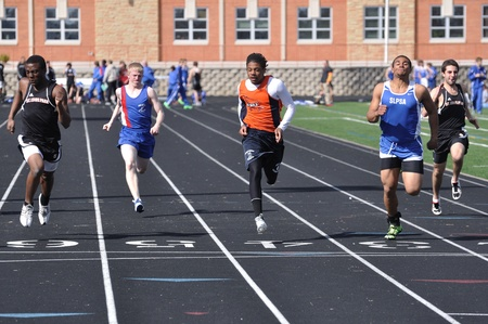 SPRING LAKE PARK, MN - May 3: Teen Boys from Spring Lake Park, St Louis Park, & Robbinsdale Competing in High School Sprint Race on May 3, 2011 in Spring Lake Park, Minnesota.