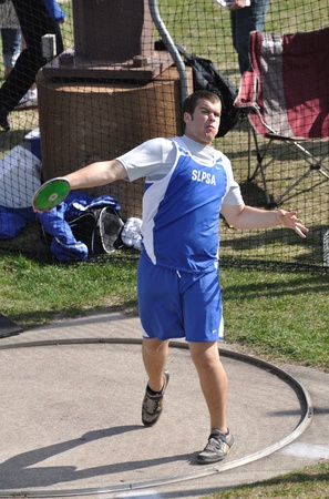 SPRING LAKE PARK, MN - May 3: Unidentified Teen Boy Throwing the Discus at a High School Track and Field Meet on May 3, 2011 in Spring Lake Park, Minnesota. Stock Photo - 10006814