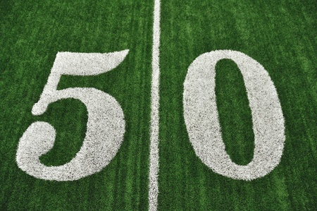 View From Above of 50 Yard Line on American Football Field With Artificial Turf photo