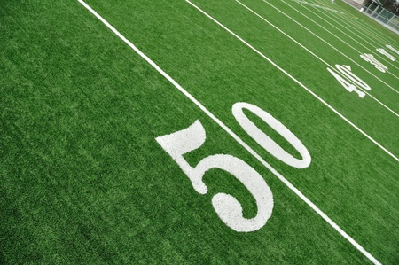 american football field: View From Above of 50 Yard Line on American Football Field With Artificial Turf