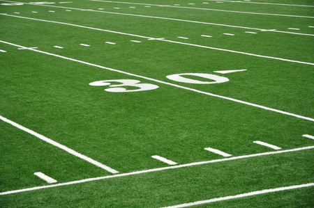 30 Yard Line on American Football Field with Hash Marks and Sideline photo