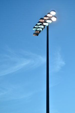 Brightly Lit Stadium Lights Against the Evening Sky Stock Photo - 10302143
