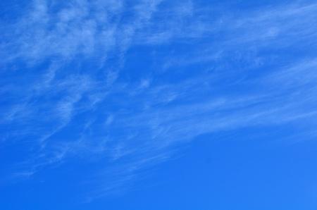 cirrus: Wispy Cirrus Clouds Against a Blue Sky Stock Photo