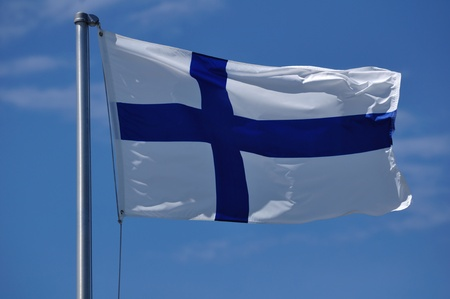 flagpole: The Flag of Finland Waving in the Breeze Stock Photo