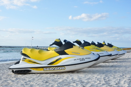riviera maya: PUERTO AVENTUARAS, MEXICO - March 13: Sea-Doo Personal Watercrafts on a Tropical Beach on a Sunny Morning at a Resort in Mexicos Riviera Maya on March 13, 2011 in Puerto Aventuras, Mexico
