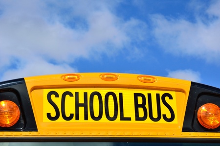school bus: Yellow School Bus with Blue Sky and Clouds