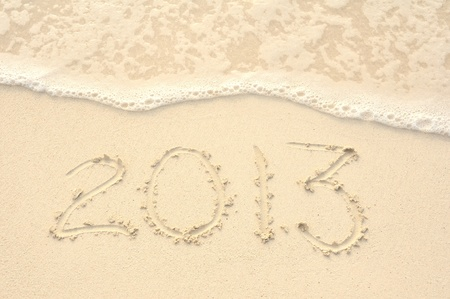 The Year 2013 Written in the Sand on a Beach photo
