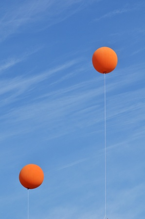 cirrus: Two Orange Balloons Against a Blue Sky with Cirrus Clouds