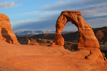 rock arch: Delicate Arch in Arches National Park at Sunset Stock Photo