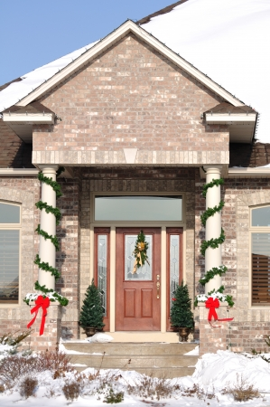 Front Entrance of Home with Christmas Decorations Stock Photo