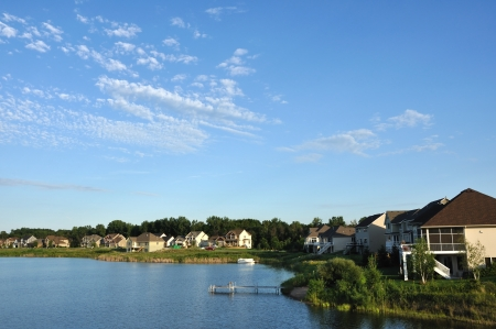 lake dwelling: Suburban Executive Houses on Lake with a Blue Sky