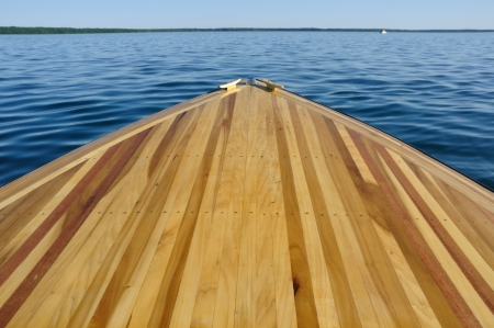 wooden deck: Wood Strip Bow Deck of Wooden Boat Using Poplar and Mahogany Stock Photo