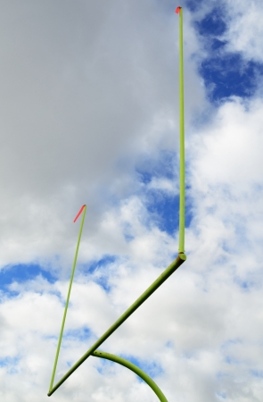 American Football Goal Posts and Clouds photo