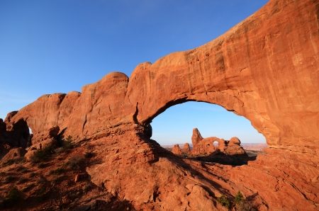 arches national park: North Window and Turret Arch in Arches National Park at Sunrise