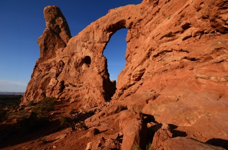 rock arch: Hiker Exploring the Turret Arch in Arches National Park at Sunrise