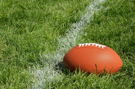 yardline: Football Near Yardline American Football on Natural Grass Field Stock Photo