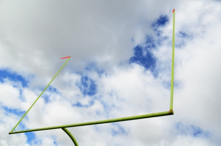 field goal: American Football Goal Posts and Clouds Stock Photo