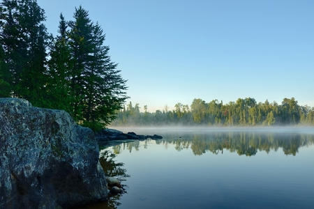 minnesota woods: Morning Reflections of a Forest on a Foggy Wilderness Lake
