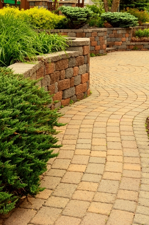 pavers: Retaining Wall and Patio with Landscaping and Pavers Stock Photo
