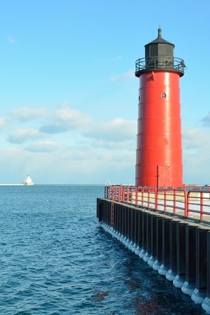 lake michigan lighthouse: Milwaukee Pierhead Lighthouse With Breakwater Light in the Distance (Located on Lake Michigan in Wisconsin)