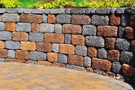 retaining: Retaining Wall and Patio with Landscaping and Pavers Stock Photo
