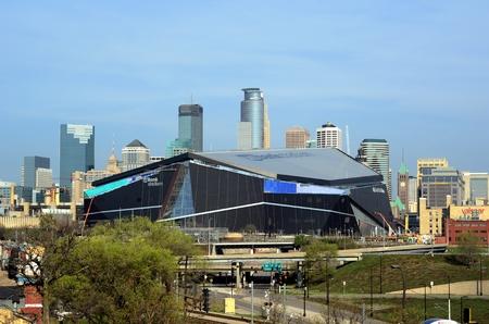 Vikings: MINNEAPOLIS, MN - APRIL 23 2016: Minnesota Vikings US Bank Stadium in Minneapolis with Downtown Skyline