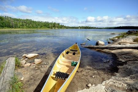 kevlar: Kevlar Canoe on the Shore of Wilderness Lake