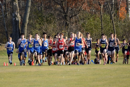 ST. FRANCIS, MN - SEPTEMBER 25 2012: Start of a Boys High School Cross Country Meet With Numerous Minnesota Teams Participating.