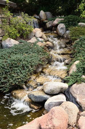 features: Waterfall Feature and Landscaping at a Residential Home