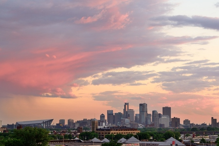 bank of america: MINNEAPOLIS, MN - MAY 24 2016: Downtown Minneapolis Skyline with Minnesota Vikings US Bank Stadium at Sunset Editorial