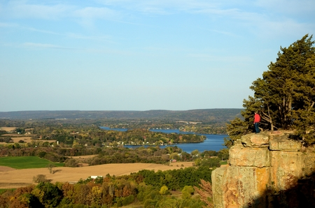 Man Standing on a Cliff at Gibraltar Rock State Natural Area in Wisconsin in the Fall
