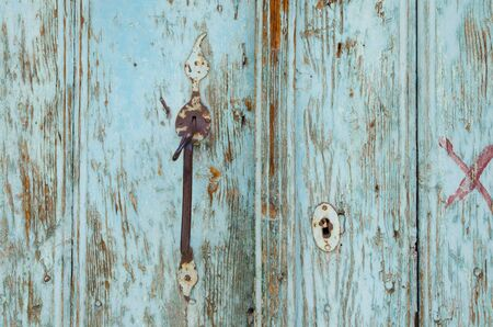 Old, turquoise Turkish door. Wood texture background