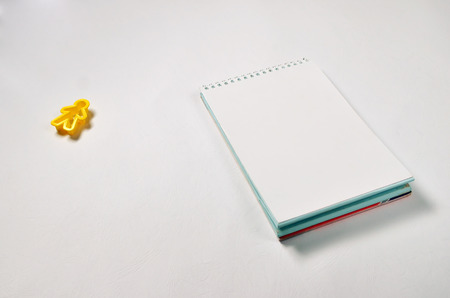 text on notepad with office accessories. Business motivation,inspiration concepts, yellow toy person on white paper background Imagens