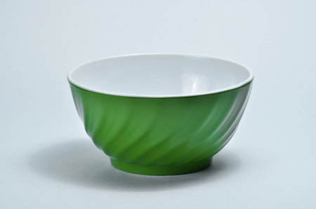 Empty green plastic bowl isolated on white background Banco de Imagens