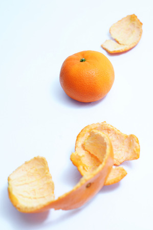 Healthy fruits, orange fruits, orange peeles skin as foreground isolated on white backdrop from top view Stok Fotoğraf