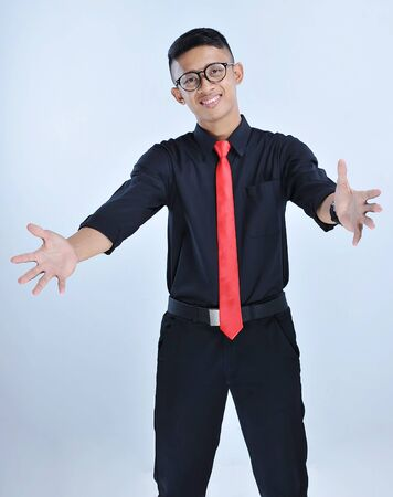 Handsome young asian business man happy and smiling do a hug gesture with glass and red tie isolated on grey background