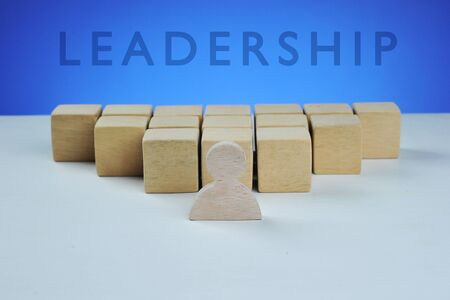 Business leadership, confidence concept using wood and cube on blue background