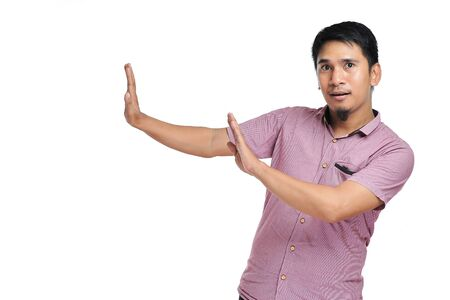 Handsome young Asian man denying, rejecting proposition, refusing bad deal offer, disagree with possible scam isolated on white background Reklamní fotografie