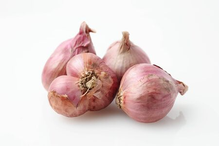 Close up of shallots or Red Spanish onion, isolated on white background