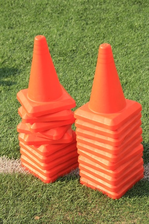Marking signs in the form of a cone on the green grass  photo