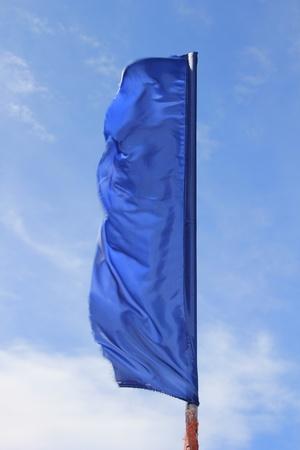 Blue flag against the sky  Stock Photo - 9704672