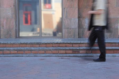 bustle: Walking on the sidewalk man