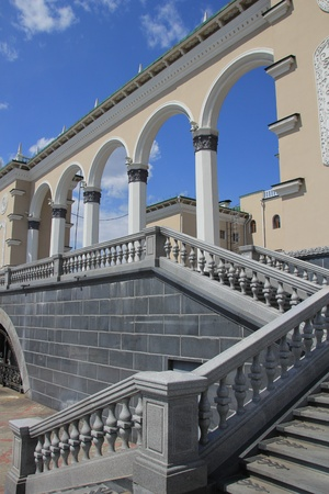 The stairs and railing made of gray marble  photo