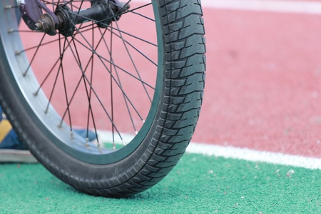 Bicycle wheel on the stadium track  photo