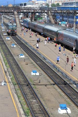 sleepers: Railroad tracks and passenger train Stock Photo